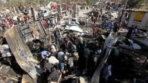 Residents gather at the site of a bomb attack at a checkpoint in the city of Hilla  south of Baghdad  March 6  2016   REUTERS Alaa Al-Marjani